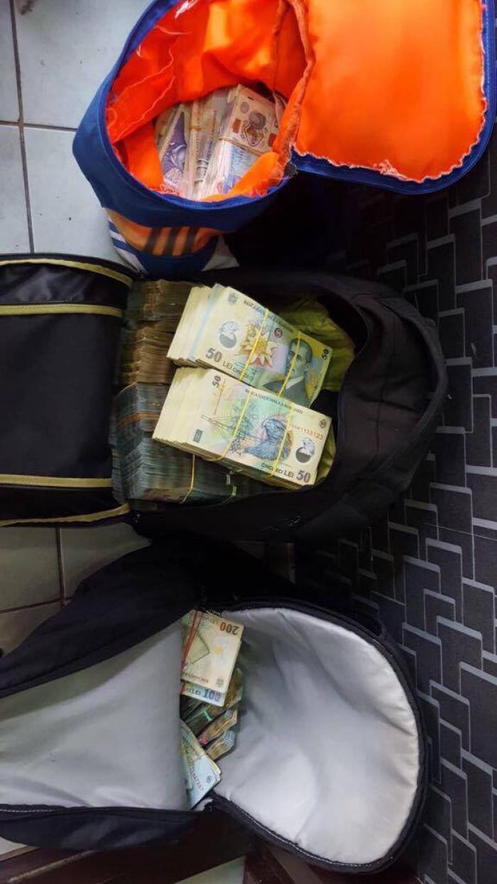 Operaţiune a mascaţilor, în Pipera! Poliţiştii au descins la case de schimb valutar şi la membrii a două grupări suspectate de evaziune fiscală şi spălare de bani