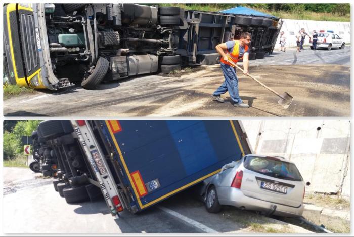 Șofer de TIR a pierdut controlul pe o urcare și s-a răsturnat peste o mașină