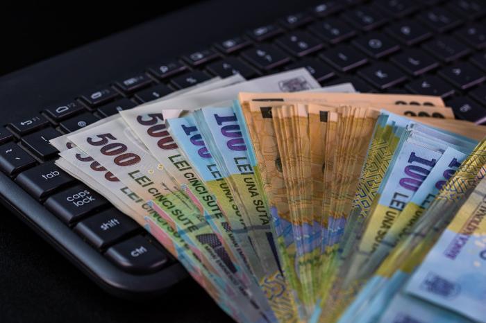 Bani pe tastatura unui calculator