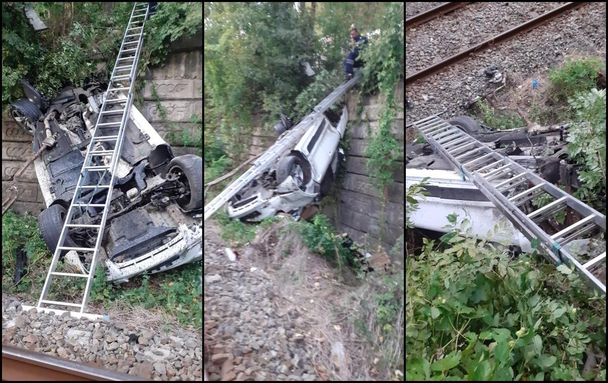 La un pas de tragedie: Autoturism căzut pe calea ferată în Vâlcea. Trei persoane au fost transportate la spital
